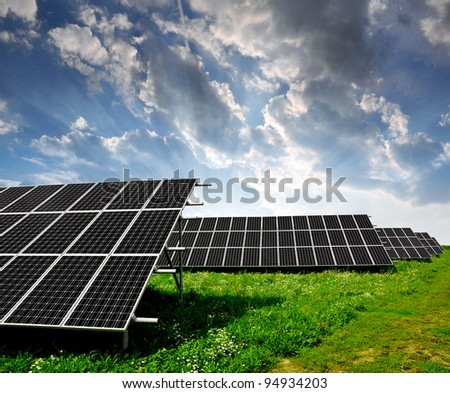 Solar panels in the sunset - stock photo