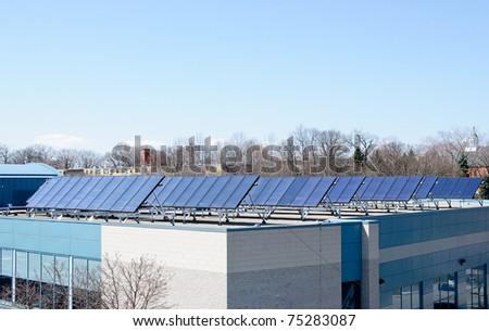 Solar Panels installed on public building - stock photo