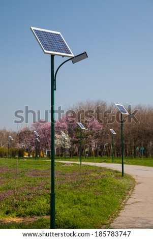 Solar panels located on a park alleys - stock photo