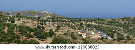 Solar panels near olive trees. Crete landscape. Greece - stock photo