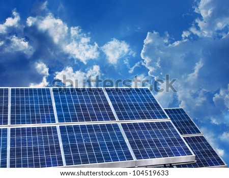 Solar panels on blue sky background - stock photo