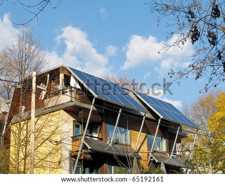 Solar panels on residential building - stock photo