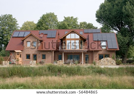 Solar panels on rural residence - stock photo