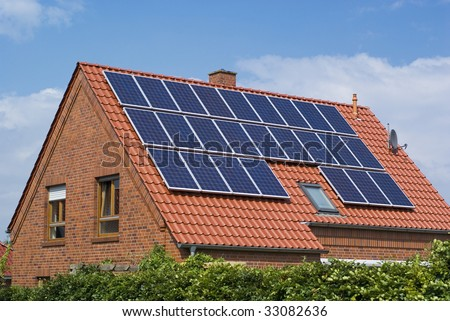 Solar panels on the roof of a house. - stock photo