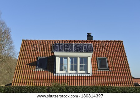 Solar panels on the roof of a single family house - stock photo