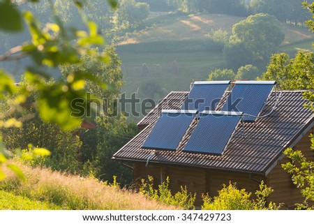 Solar panels on the roof of private home - stock photo