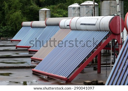 solar panels powering heated water placed on rooftops  - stock photo