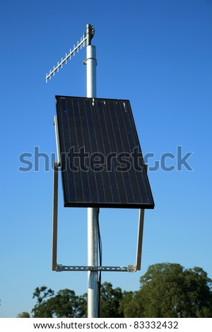 solar panels produce electricity for a transmitting beacon at a remote location where other forms of electricity do not exist - stock photo