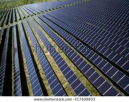 Solar panels producing green, environmentally friendly energy from the sun - stock photo