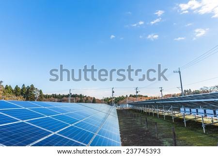 Solar panels, Solar panels against blue sky - stock photo