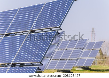Solar panels to produce energy in an environmentally friendly manner - stock photo