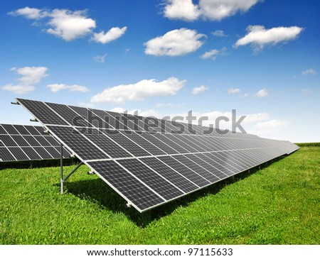 Solar panels with blue sky - stock photo