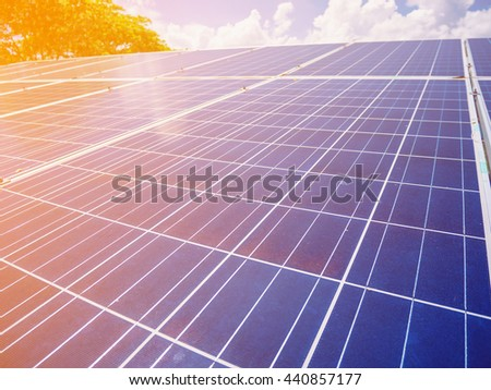 Solar panels with blue sky and clouds, solar energy environmentally friendly green energy - stock photo