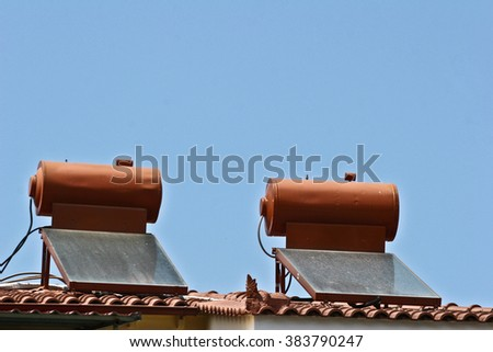Solar pannels on a roof house in  Peloponese in greece in the summer - stock photo