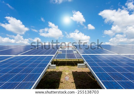 Solar power for electric renewable energy from the sun, solar farm - stock photo