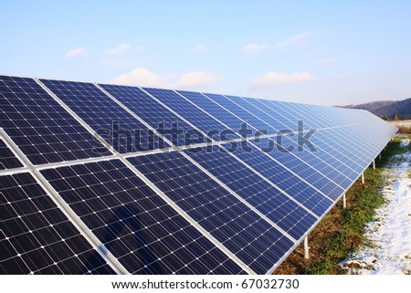 Solar Power Station in the snowy Nature - stock photo