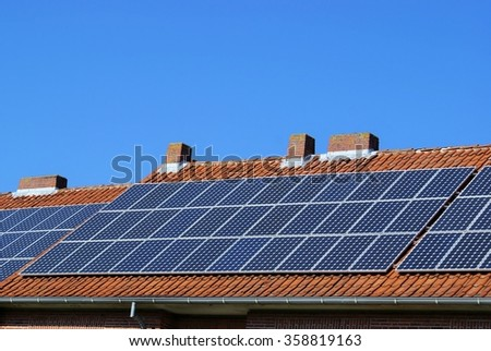 Solar power system on a residential building - stock photo