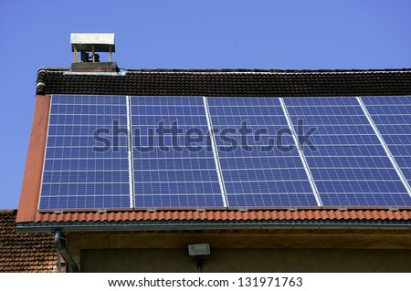 solar roof of a French viticulture cooperative in the vicinity of Anduze - stock photo