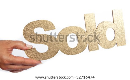 sold in gold with hand - stock photo