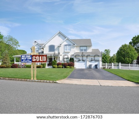 Sold Real Estate Sign Adult Mannequin Suburban Mcmansion house front sunny blue sky clouds USA residential neighborhood - stock photo
