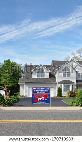 Sold Real Estate Sign Driveway Suburban Home Residential Neighborhood USA Blue Sky Clouds - stock photo