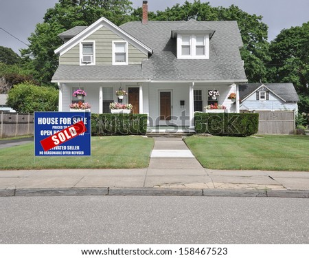 Sold Real Estate Sign Front yard Lawn Suburban Landscaped Home Residential Neighborhood USa - stock photo