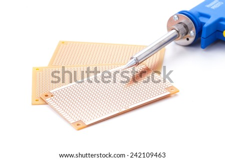 Soldering Gun Shape placed on the pcb. Electronic printed board. - stock photo