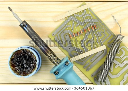 Soldering of electronic components - stock photo