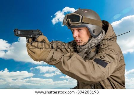 Soldier aiming a gun - stock photo