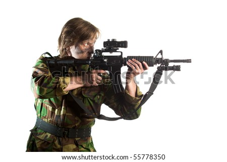 soldier aiming a riffle - stock photo