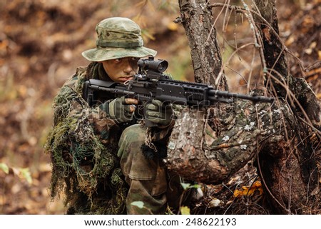 soldier aiming through the scope - stock photo