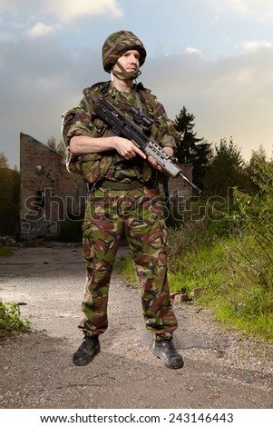 Soldier and his weapon - stock photo