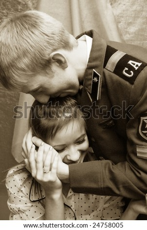 soldier and woman embrace - stock photo