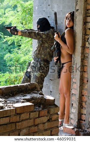 Soldier and young frightened woman in ambush - stock photo