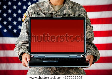 Soldier: Anonymous Woman Holding Blank Laptop - stock photo