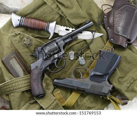 Soldier background of two guns, knife, medallions and leather case - stock photo