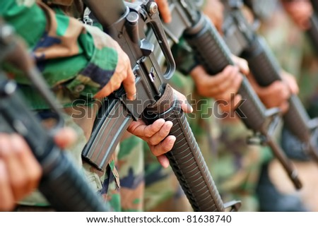 soldier carrying  M 16  in combat training - stock photo