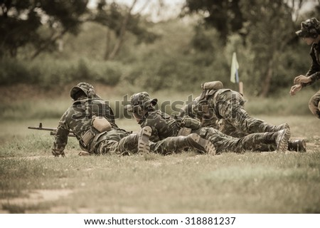Soldier , Commando Rangers team aiming at a target . Automatic Weapon machine gun , (AARM 2015) - stock photo