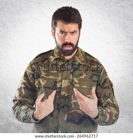 Soldier doing surprise gesture  - stock photo