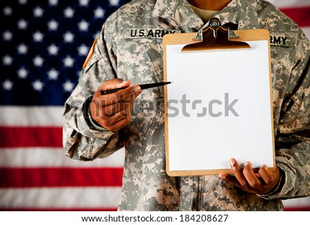 Soldier: Gesturing to a Blank Paper on Clipboard - stock photo