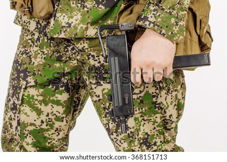 Soldier holding a black handgun. Training of soldiers firing pistol . - stock photo