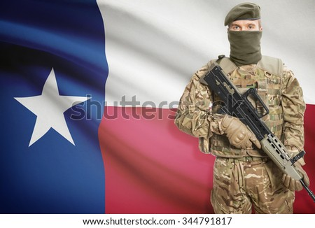 Soldier holding machine gun with USA state flag on background - Texas - stock photo