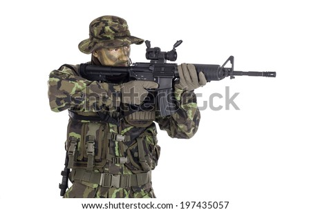 Soldier in camouflage and modern weapon M4. Isolated on white background - stock photo