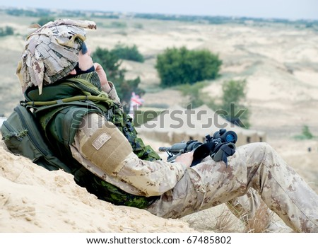 soldier in desert uniform at rest - stock photo