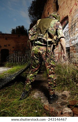 Soldier in field making patrol bed - stock photo
