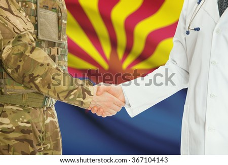 Soldier in uniform and doctor shaking hands with US states flags on background - Arkansas - stock photo