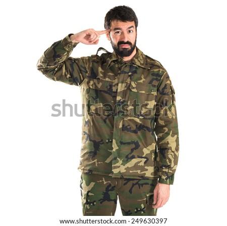 Soldier making crazy gesture  - stock photo