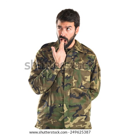 Soldier making suicide gesture  - stock photo