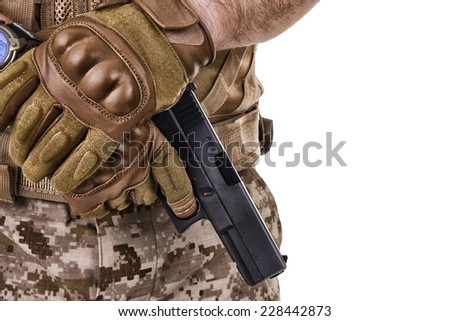 Soldier man holding his gun - stock photo