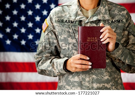 Soldier: Military Woman Holding Bible - stock photo